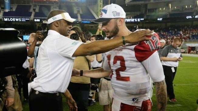 Willie Taggart, who recruited Brandon Doughty to WKU as head coach, greets him after WKU's win in the Miami Beach Bowl. (AP photo)
