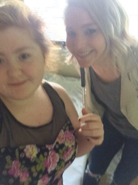 Jennifer Lawrence poses at Kosair Children's Hospital with Bailey Fullen (photo courtesy Bailey Fullen).