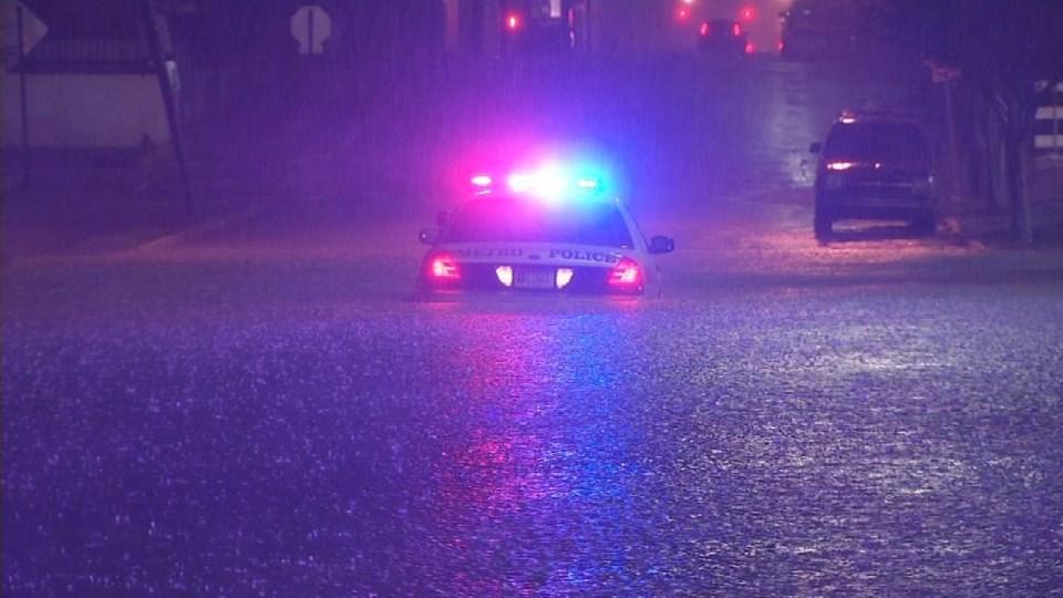 An LMPD car got stuck in high water near the Louisville Extreme Park Wednesday night, Dec. 23, 2015.