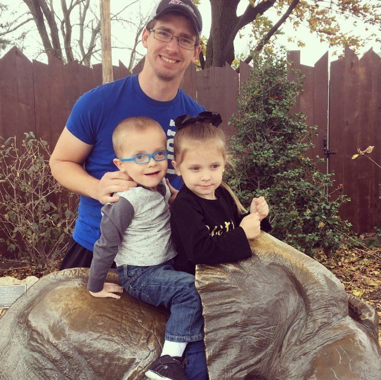 Conor and his 4-year-old sister, Claire, with their dad, Ethan.