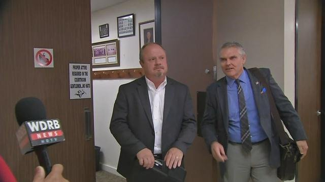 Jeffersonville city council member at-large (elect) Steve Webb (left) leaves Clark Circuit Court with attorney Larry Wilder (right) after Monday's recount hearing.
