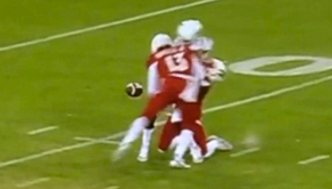 Louisville linebacker James Burgess said he was not guilty of targeting on the first play of the Music City Bowl.