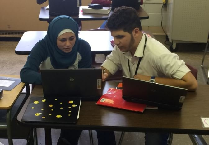 Nour Alkunuss, 18, and a classmate go over an assignment at the ESL Newcomer Academy, which is located on the third floor of the Academy @ Shawnee (Toni Konz, WDRB, News)