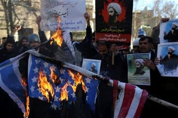 (AP Photo/Vahid Salemi). Iranian demonstrators burn representations of the U.S. and Israeli flags during a demonstration in front of the Saudi Arabian Embassy in Tehran, Iran, to protest the execution of Saudi Sheikh Nimr al-Nimr.