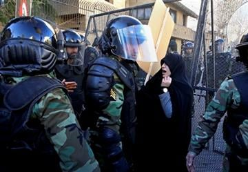 (AP Photo/Vahid Salemi). Police officers try to disperse protestors during a protest denouncing the execution of Sheikh Nimr al-Nimr, a prominent opposition Saudi Shiite cleric, in front of the Saudi Embassy in Tehran, Iran, Sunday, Jan. 3, 2016.