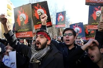 (AP Photo/Vahid Salemi). Iranian demonstrators chant slogans during a protest denouncing the execution of Sheikh Nimr al-Nimr, a prominent opposition Shiite cleric in Saudi Arabia, seen in posters, in front of the Saudi Embassy, in Tehran.