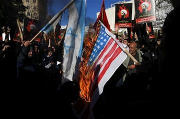 (AP Photo/Vahid Salemi). Iranian demonstrators burn a representation of the U.S. and Israeli flags during a demonstration in front of the Saudi Arabian Embassy in Tehran, Iran, to protest the execution of Sheikh Nimr al-Nimr.