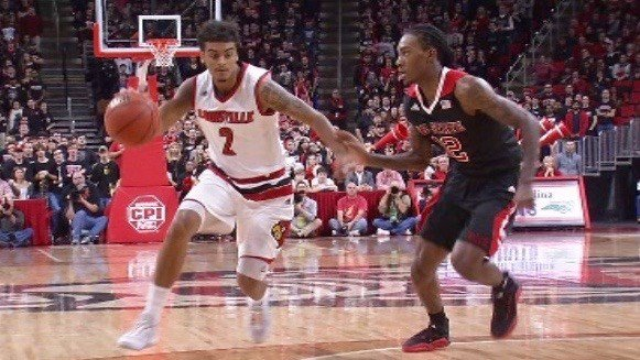 Quentin Snider works on N.C. State's Cat Barber in Louisville's 77-72 win Thursday. (WDRB photo by John Lewis)