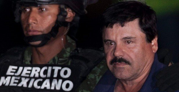 "Jan. 8, 2016: Mexican drug lord Joaquin ""El Chapo"" Guzman, right, is escorted by soldiers and marines to a waiting helicopter, at a federal hangar in Mexico City (AP)"
