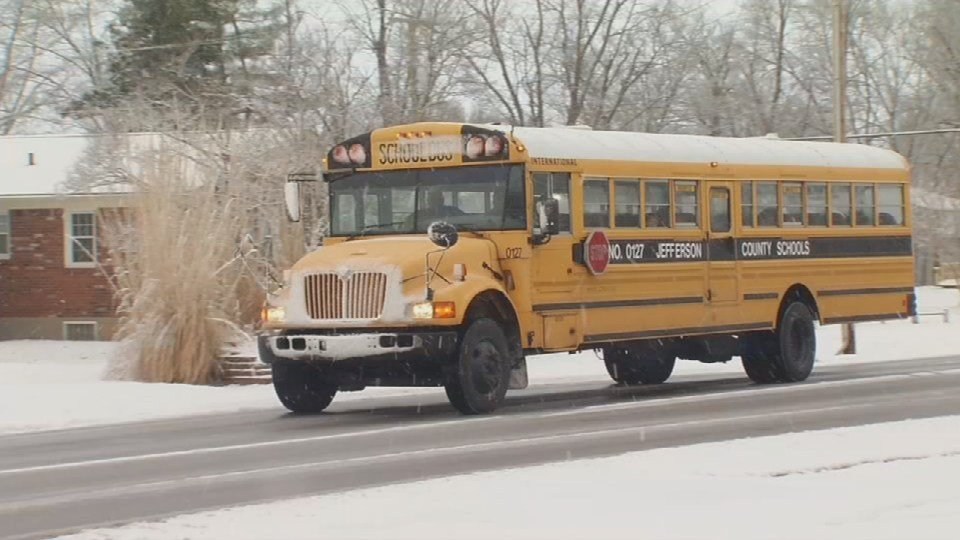 A JCPS bus navigates snowy roads during the 2014-2015 school year in this WDRB file photo.