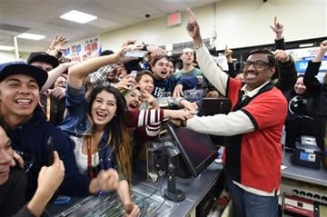 (Will Lester/The Sun via AP). 7-Eleven store clerk M. Faroqui celebrates with customers after learning the store sold a winning Powerball ticket on Wednesday, Jan. 13, 2016 in Chino Hills, Calif.