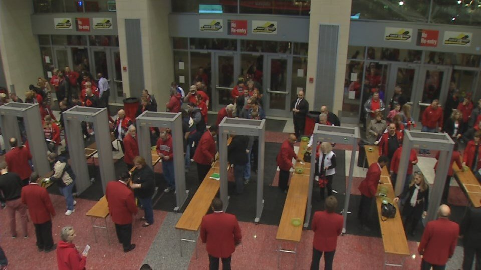 The security lines pass through the metal detectors as fans were first let into the Yum Center.