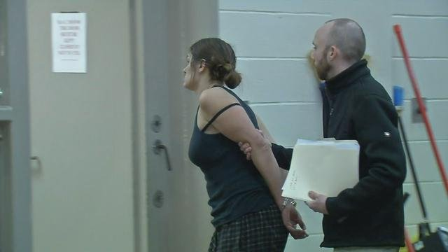 Tara Snawder (aka Tara Van Winkle) is escorted into jail after being arrested at a Madison, Ind. Walmart on Jan. 14, 2016.