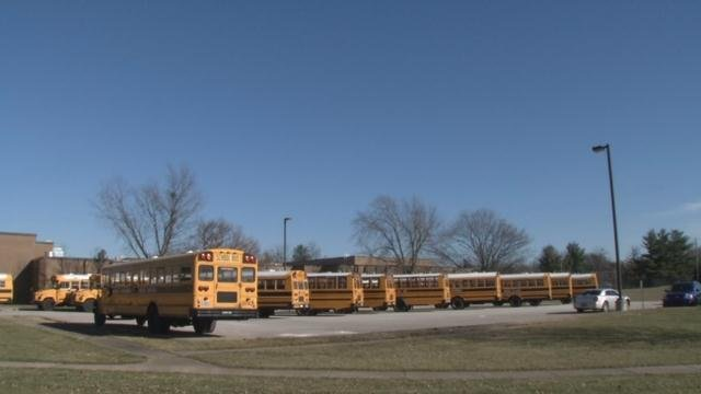 JCPS buses wait at the compound under clear skies Tuesday, Jan. 19, 2016, but an uncertain forecast puts officials in a tough spot overnight.