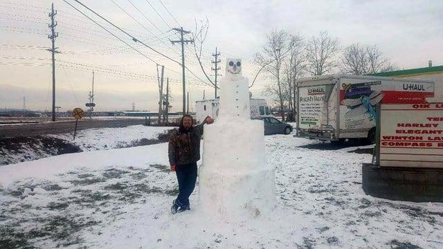 10-ft. snowman outside Qik Lube in Jeffersonville, Indiana (source: Micah Triplett via Facebook)