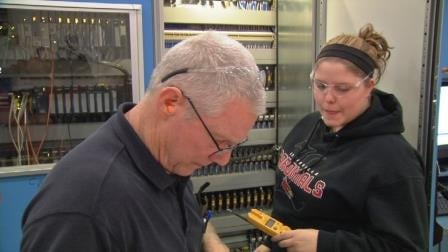 Greg Fentress, a maintenance technician with 24 years at GE Appliances, and his student apprentice Aliza Schmitter