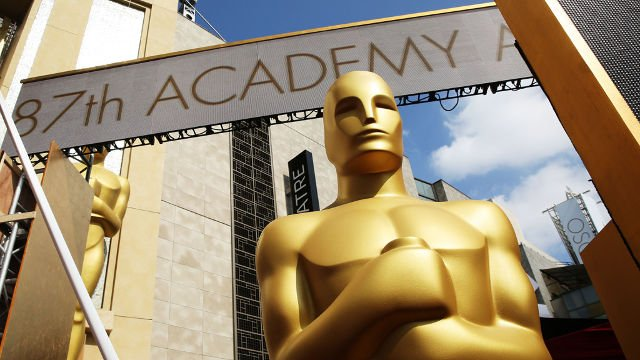 An Oscar statue is seen as preparations are made for the 87th Academy Awards in Los Angeles, Saturday, Feb. 21, 2015. The Academy Awards will be held at the Dolby Theatre on Sunday. The Associated Press