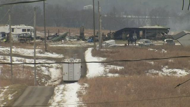 Officials were working to determine a cause of an explosion and fire in Adair County, Ky. on Jan. 26, 2016 that left one person dead and three others unaccounted for.