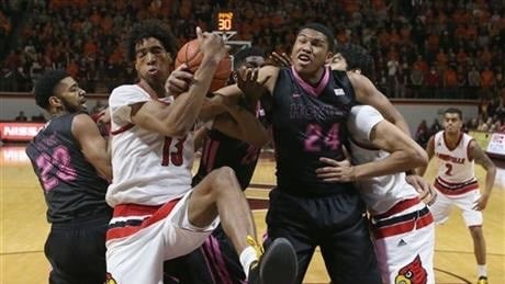 Louisville freshman Raymond Spalding wrestles down a rebound in Wednesday's win at Virginia Tech. (AP photo)