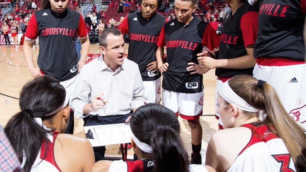 Jeff Walz speaks to his team before Thursday's win over Clemson. GoCards.com photo by Michelle Hutchins. See a gallery from the game here http://www.gocards.com/galleries/?gallery=2835