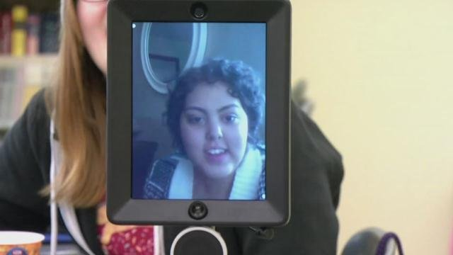 Jaden Cloyes is able to virtually attend all her classes by using an internet-connected iPad with a camera attached to a Segway.