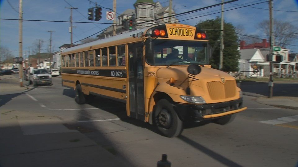 A JCPS bus gets ready to drop off students in the Portland neighborhood on Dec. 1 (WDRB file photo)
