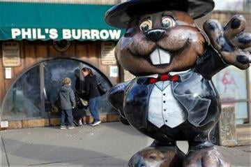 """(AP Photo/Keith Srakocic). Visitors look through the windows at the Punxsutawney Public Library where groundhogs are on display at """"Phil's Burrow"""" in Punxsutawney, Pa., Monday, Feb. 1, 2016."""