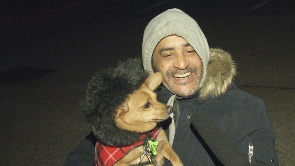 Alberto Santiago and his dog, Chico.