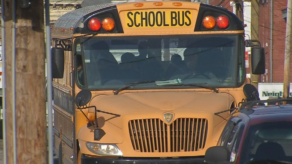 A JCPS bus driver gets ready to drop students off in the Portland neighborhood on Dec. 1. (WDRB file photo)