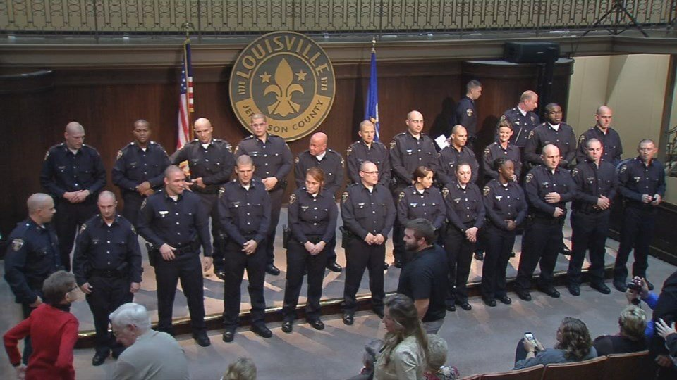 LMPD recruits attend a graduation ceremony in the Mayor's Gallery at Metro Hall in Louisville.