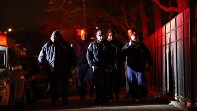 Two police officers were shot while on patrol in a public housing project on Thursday night and suffered non-life-threatening injuries, and a suspect was in custody, authorities said. (AP Photo/Julio Cortez)