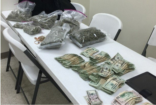 Police in Bullitt County say they found about eight pounds of marijuana and $30,410 in cash during a traffic stop on Feb. 12, 2016.