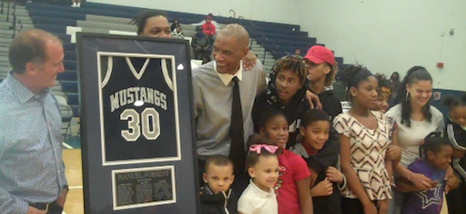 Manuel Forrest celebrated with family and friends as Moore High retired his number Tuesday night.