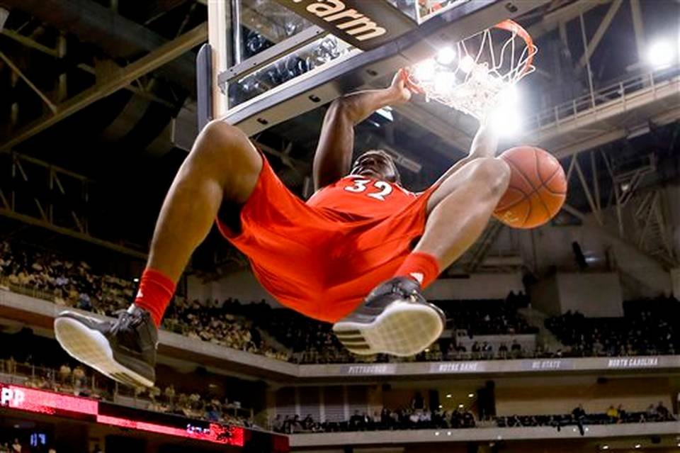 Chinanu Onuaku finishes a slam dunk at Pittsburgh. (AP photo)
