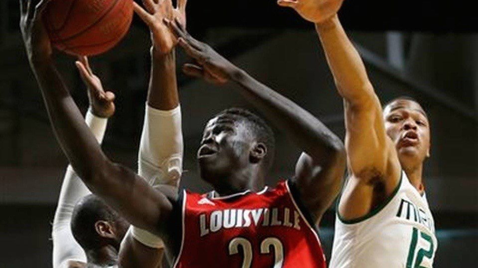 Deng Adel drives for a basket in Louisville's loss to Miami. (AP photo)