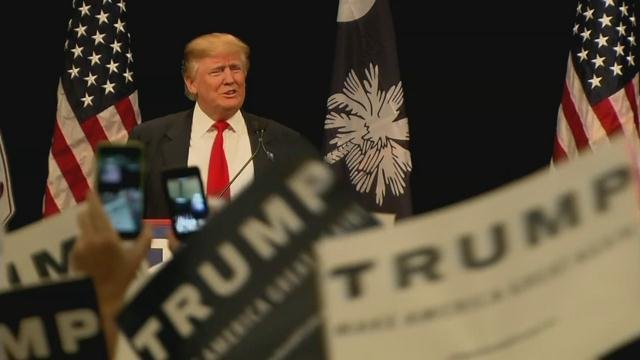 In this WDRB file photo, Trump appears on stage at a rally in Louisville.