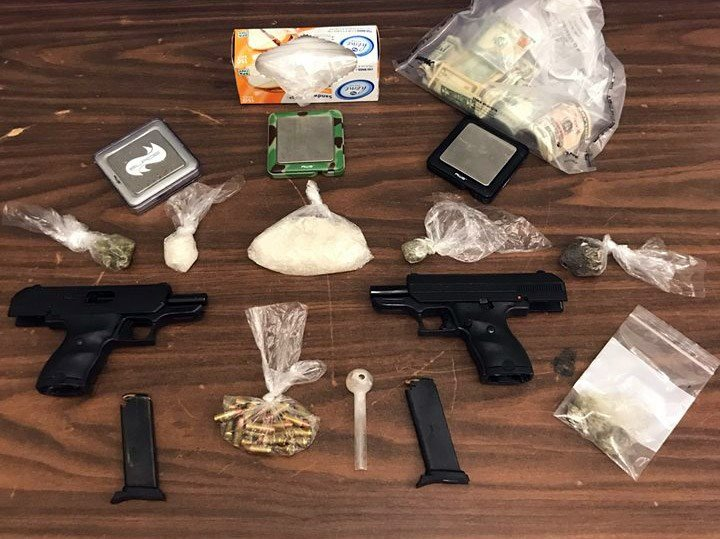 Drugs and guns allegedly seized during the search. (Image courtesy: Louisville Metro Police Department)