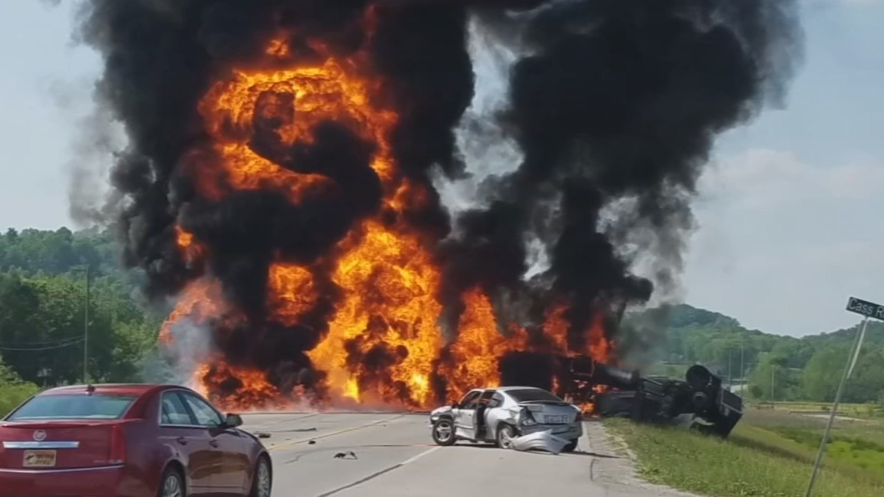 A semi truck filled with gasoline caught fire in Rockcastle County, Kentucky, on Mother's Day, and witnesses say the only reason the driver is still alive is an anonymous hero who wouldn't give up until the truck driver was pulled to safety.