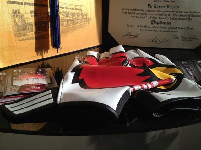 Rogers' diploma and receivers' gloves are proudly displayed