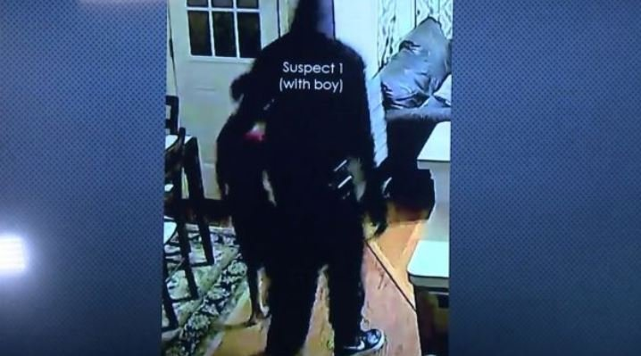 One of the suspects can be seen leading the couple's 7-year-old son around the home looking for money. (Image courtesy: FOX26 via FOX News)